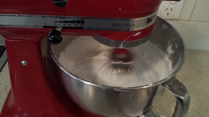 Beat Meringue for 30 seconds between adding batches of 1 Tablespoon of sugar.